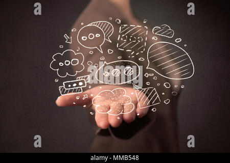 Thought bubbles in the hands of a young casual businesswoman  - Stock Photo