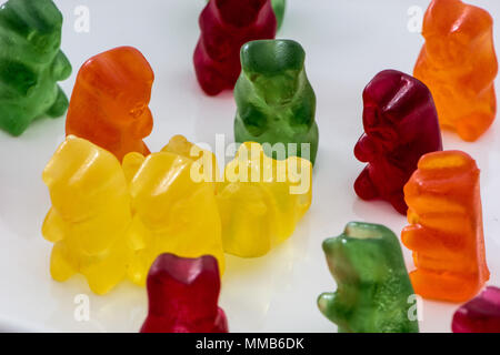 Gummy or jelly bears isolated on white background. Kids famous and lovely sweet or candy