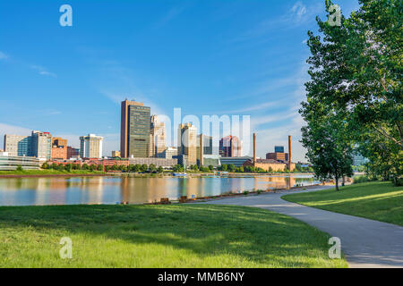 A panoramic view of downtown Toledo Ohio's skyline from across the Maumee river at a popular public park. - Stock Photo