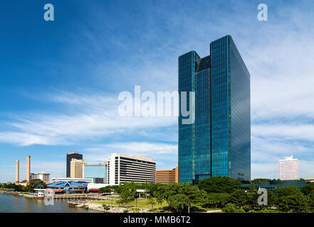 A panoramic view of downtown Toledo Ohio's skyline and the Maumee river.  A beautiful  blue sky with white clouds for a backdrop. - Stock Photo