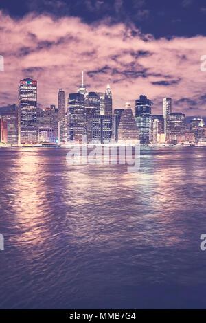 Vintage toned Manhattan skyline at night, New York City, USA. - Stock Photo