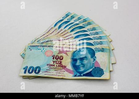 ten bills per 100 lira together making one thousend lira - Stock Photo