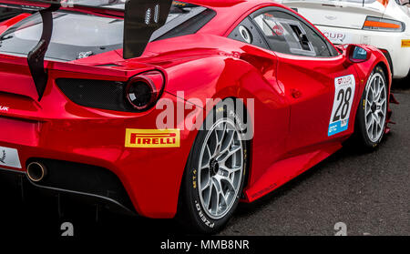 A modern, red Ferrari 488 GT3 racing car at the 2018 GT Cup race at Donnington Park race circuit - Stock Photo