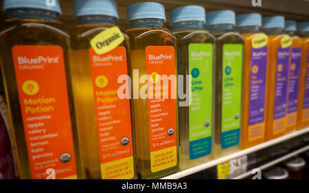 Bottles of Blueprint organic vegetable and fruit drinks, a brand of the Hain Celestial Group, in a supermarket in New York on Tuesday, May 8, 2018. The Hain Celestial Group reported fiscal third-quarter earnings that missed analysts' expectations citing transportation and commodity costs.  (© Richard B. Levine) - Stock Photo