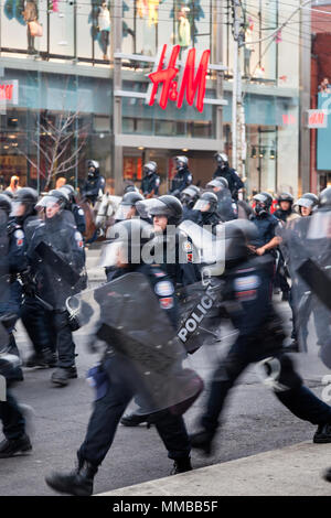Riot police in action along Queen Street West during the G20 summit in Downtown Toronto, Ontario, Canada. - Stock Photo