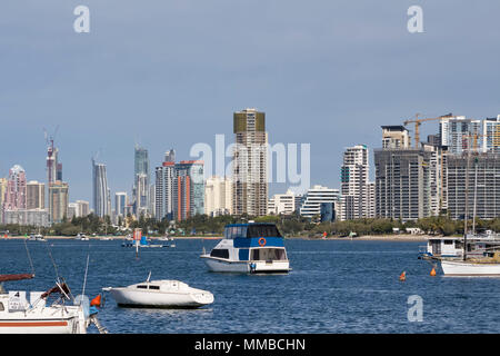 Boats moored at the Gold Coast with High rise in the background. - Stock Photo