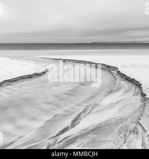 Lovely minimalist landscape black and white image of empty beach at low tide - Stock Photo