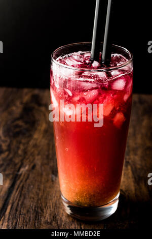 Alabama Slammer Cocktail with black straw. Beverage Concept. - Stock Photo