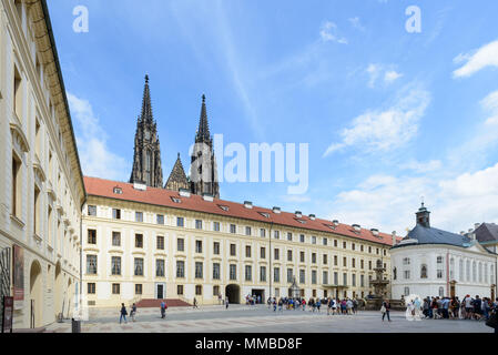 Prague, Czech republic - July 25, 2017: Tourists in Prague Castle, a castle complex in Prague, Czech Republic. The official office of the President of - Stock Photo