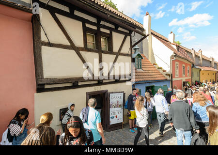 Prague, Czech republic - July 25, 2017: tourists in the Golden Lane, Czech  Zlata ulicka, is a street situated in Prague Castle, Czech Republic - Stock Photo