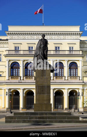 Warsaw, Mazovia / Poland - 2018/04/22: Juliusz Slowacki monument in front of historic building of Treasury Ministry Palace as part of Warsaw City Hall - Stock Photo