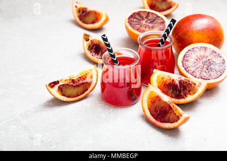 blood orange juice. red orange juice with orange slice. Healthy drink. - Stock Photo