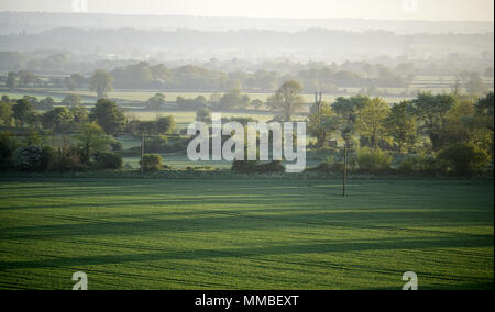 The sun rises over the Wiltshire village of Edington. - Stock Photo