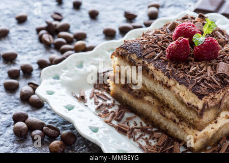 Dessert Tiramisu Cake with Grated Chocolate, Raspberry and Mint - Stock Photo