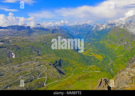 Panoramic view from top of Dalsnibba on Nibbevegen road leading down to Geiranger Fjord, Norway - Stock Photo