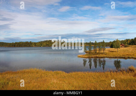 Indian Summer and autumn colors on a lake in Finland - Stock Photo