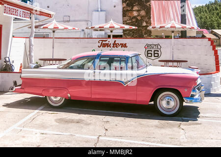 WILLIAMS, ARIZONA - JULY 3, 2007: Classic pink Ford Fairlane Crown Victoria (1955) parked in front the Route 66 Place and Twisters Restaurant in Willi - Stock Photo