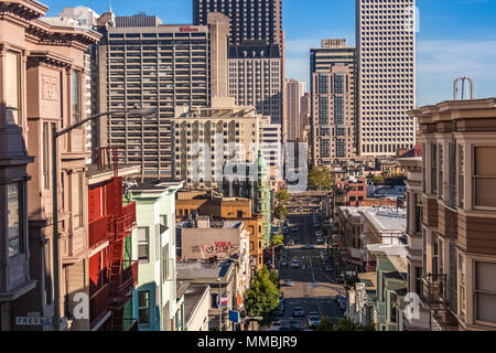 San Francisco skyline through Kearney Street as seen from Telegraph Hill toward the South in summer. - Stock Photo