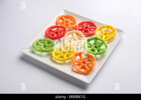 wheel shape colourful fryums papad snack. selective focus - Stock Photo