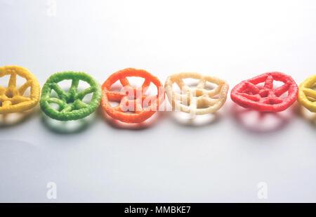 wheel shape colourful fryums papad snack. selective focus - Stock Photo