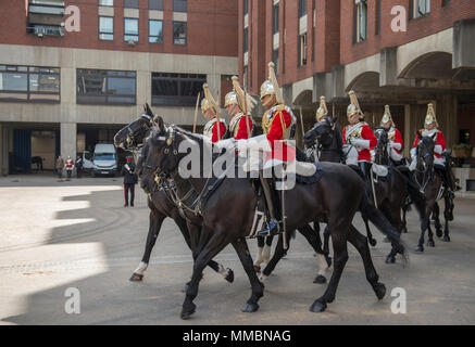 London, UK. Behind-the-scenes 'Day in the Life' of the Household Cavalry Mounted Regiment'. Life Guards leave for daily duties. - Stock Photo