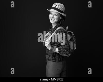 Searching for inspiring places. Portrait of happy active tourist woman with backpack isolated on background - Stock Photo