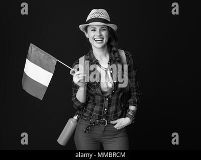 Searching for inspiring places. happy active tourist woman in a plaid shirt with the flag of Italy isolated on - Stock Photo