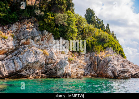 Beautiful view of tropical beach and sea, Scenery view to a sea bay with blue waters, green mountains.blue lagoon beach coast in the ionian sea landscape - Stock Photo