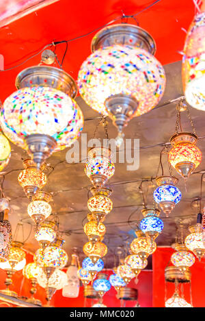 Traditional colorful handmade Turkish lamps and lanterns hanging in souvenir shop for sale - Stock Photo