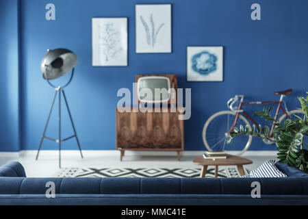 Small old fashioned television in retro style living room - Stock Photo