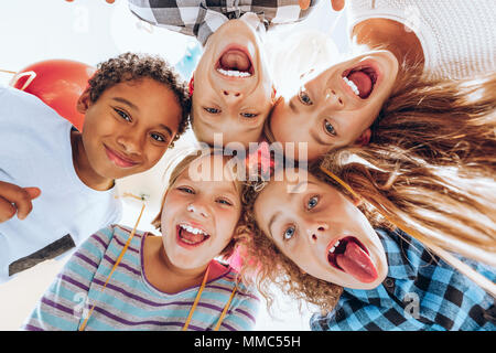 Group of children friends laughing and having fun - Stock Photo