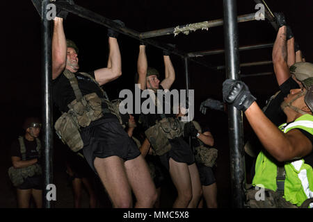 Airmen with 353rd Battlefield Airmen Training Squadron perform physical fitness at Joint Base San Antonio–Medina Annex during Tactical Air Control Party training Sept. 12, 2017. The course prepares candidates to operate in austere environments and engage enemies in close proximity to friendly forces with direct airstrikes. (U.S. Air Force photo by Ismael Ortega.) - Stock Photo
