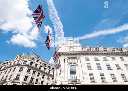 Close up of buildings on Regent Street London with row of British flags to celebrate the Royal Wedding of Prince Harry to Meghan Markle. - Stock Photo