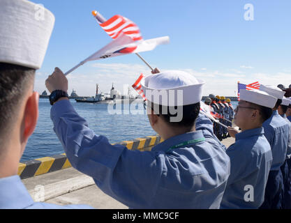171013-N-TB148-013 BUSAN, Republic of Korea (Oct. 13, 2017).The Ohio-class guided-missile submarine USS Michigan (SSGN 727) (Gold) pulls into the pier of Republic of Korea's Busan Naval Base as part of a routine port visit. The visit is to strengthen the already strong relationship between the U.S. Navy and the people of the Republic of Korea. (U.S. Navy photo by Mass Communication Specialist Seaman William Carlisle) - Stock Photo