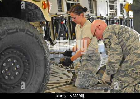 Airmen prepare an Ohio Army National Guard Humvee onto a C-17 Globemaster III Oct. 11, 2017, at Rickenbacker Air National Guard Base in Columbus, Ohio. About 40 Soldiers from the 137th Signal Company, based in Newark, Ohio, are deploying to Puerto Rico to provide communications support to hurricane relief efforts. (Ohio National Guard photo by 1st Lt. Aaron Smith) - Stock Photo