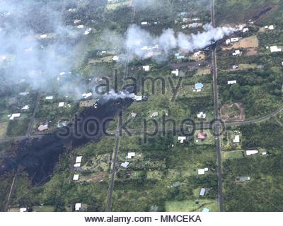 P?hoa, United States. 10th May, 2018. Aerial picture shows volcanic gases and smoke billowing in Leilani Estates in Hawaii on May 5, 2018 in the aftermath of eruptions from the Kilauea volcano. The volcano has since displaced some 1,700 people and destroyed 36 structures. Scientists have warned that ongoing surge in volcanic activity on the Big Island soon could cause a massive explosion from the summit. (c) copyright Credit: CrowdSpark/Alamy Live News - Stock Photo