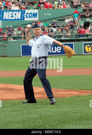 Col. Roman L. Hund, installation commander, throws the first pitch prior to a Boston Red Sox game at Fenway Park in Boston Sept. 14. Local service members were provided tickets to the game as part of the 'Tickets for Troops' program, in which season ticket holders donated their game tickets to active duty military members. (U.S. Air Force photo by Mark Herlihy) - Stock Photo