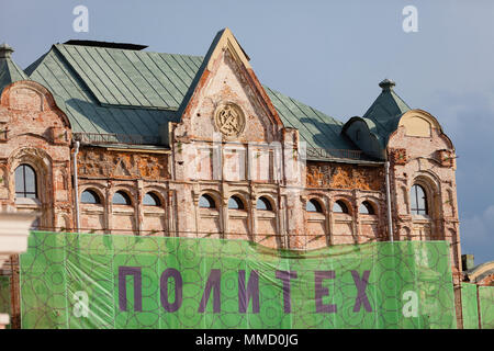 MOSCOW, RUSSIA - APRIL 30, 2018: View of the historical building of the Polytechnic Museum, which is under restoration. Tower cranes. Protective mesh. - Stock Photo