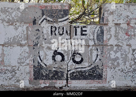 A peeling Route 66 mural painted on a wall in the parking lot of the former Club Cafe in Santa Rosa, New Mexico. The restaurant has been torn down. - Stock Photo