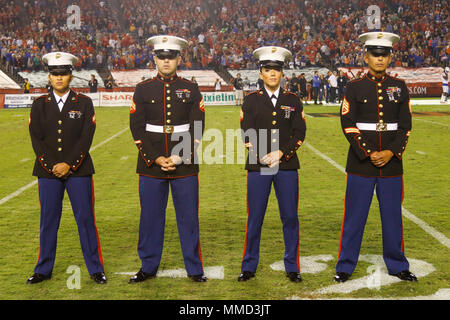 U.S. Marine Corps Cpl. Naoko Yulee, Distribution Management Specialist, left, Cpl. Devyn McDowell, Mortar Man, Sgt. Anairam Stephens, Canvassing Recruiter, and Staff Sgt. Joaquin Perez, Drill Instructor, are individually recognized for their dedication to service during the San Diego State University (SDSU) vs Boise State University (BSU) at the San Diego County Credit Union Stadium, San Diego, Calif., Oct. 14, 2017. BSU defeated San Diego State University, 31-14. (U.S. Marine Corps imagery by Lance Cpl. Jesus McCloud) - Stock Photo