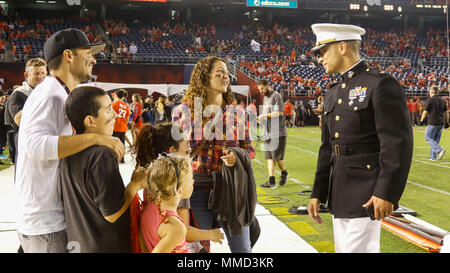 U.S. Marine Corps Maj. Jared Reddinger, Commanding Officer Recruiting Station San Diego, socializes with a family during the San Diego State University (SDSU) vs Boise State University (BSU) football game at the San Diego County Credit Union Stadium, San Diego, Calif., Oct. 14, 2017. BSU defeated San Diego State University, 31-14. (U.S. Marine Corps imagery by Lance Cpl. Jesus McCloud) - Stock Photo