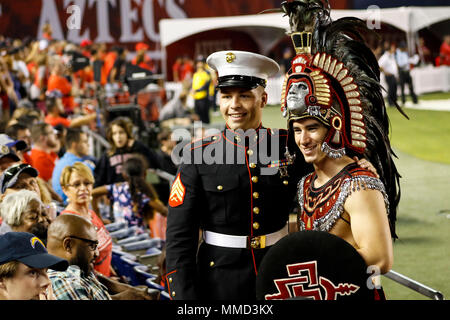 U.S. Marine Corps Sgt. William Hester, Marketing and Public Affairs representative, Recruiting Station San Diego, poses with the San Diego State University (SDSU) Aztec mascot during the SDSU vs Boise State University (BSU) at the San Diego County Credit Union Stadium, San Diego, Calif., Oct. 14, 2017. BSU defeated San Diego State University, 31-14. (U.S. Marine Corps imagery by Lance Cpl. Jesus McCloud) - Stock Photo