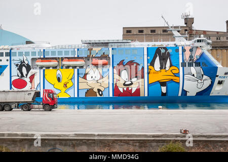 LA SPEZIA, ITALY : JUNE 15th, 2005 : Moby Lines Moby Wonder ferry ship with characters of Looney Tunes drawn at the side of the ship, docked in a port - Stock Photo