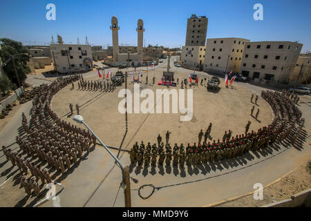 NATIONAL TRAINING CENTER, ISRAEL (March 14, 2018) U.S. Marines assigned to Battalion Landing Team, 2nd Battalion, 6th Marine Regiment (BLT 2/6), 26th Marine Expeditionary Unit (MEU) and Israeli Defense Force soldiers with 35th Airborne Brigade, 98th Paratroopers Division participate in the closing ceremony of exercise Juniper Cobra 2018 at the National Training Center in Israel, March 14, 2018. Juniper Cobra is a computer-assisted exercise conducted through computer simulations focused on improving combined missile defense capabilities and overall interoperability between the U.S. European Com - Stock Photo