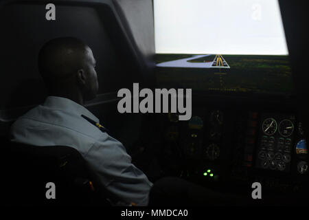 A student operates a flight simulator at the Senegalese Air Force Training Academy in Thiès, Senegal, March 20, 2018. The school trains both pilots and maintanence personnel, and has students not only from Senegal, but other west African nations as well. (U.S. Air Force - Stock Photo