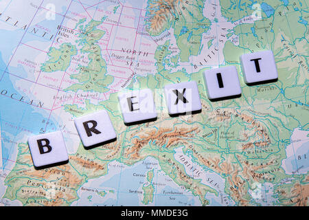 London, UK: January 11, 2018: Close up of the word Brexit over a map of Europe. Britain is scheduled to leave the European Union at midnight on March - Stock Photo