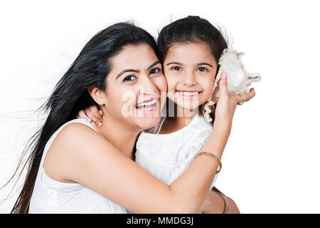 Happy Mother And Kid Girl listening to conch shell, Enjoy - Stock Photo