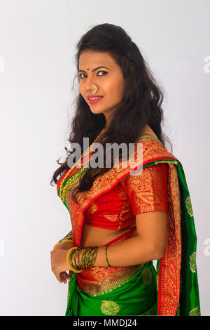 Stylish Indian woman in silk saree and nose ring in a side pose