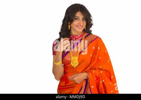 Stylish Indian woman in silk saree and jewelry