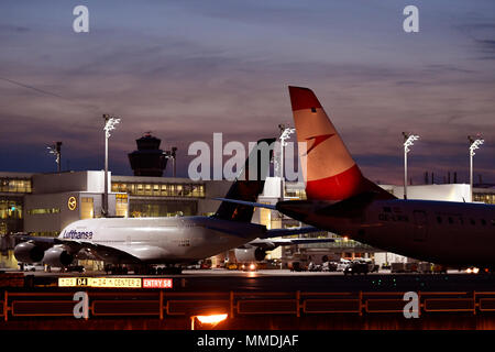 A 380-800, A380, Lufthansa, position, ramp, night, twilight, lights, sunset, Aircraft, Airplane, Plane, Airport Munich, MUC, Germany, - Stock Photo